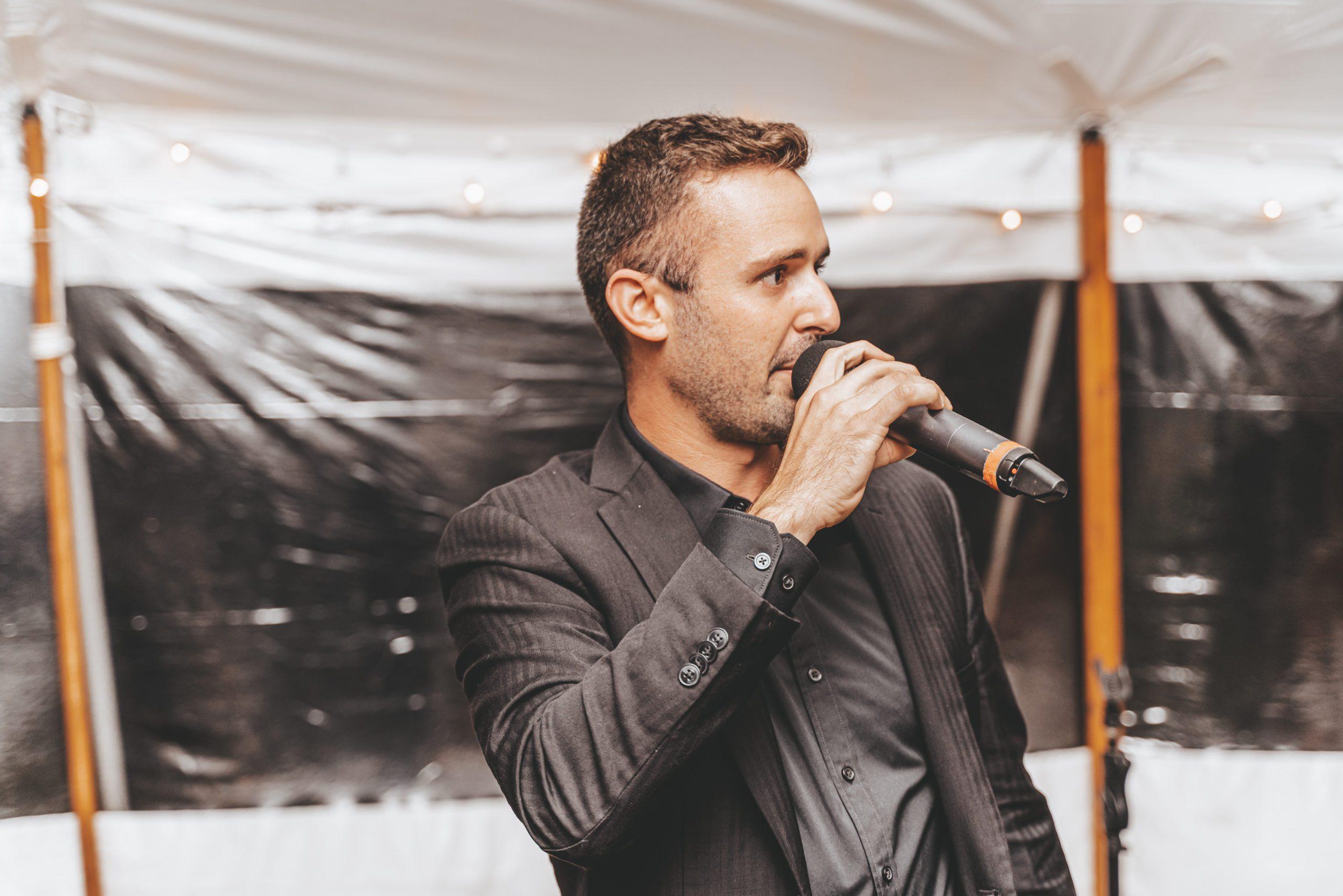 Wedding MC David Buono on microphone